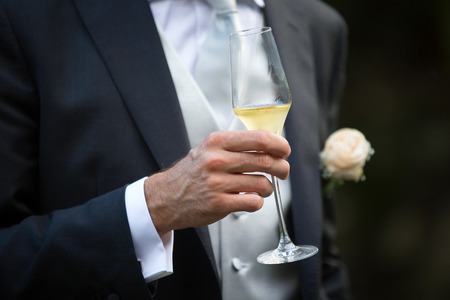 Groom and Champagne Glass in a Wedding Day photo