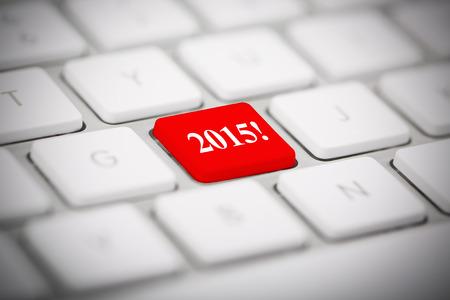 The number 2015 written on metallic keyboard photo