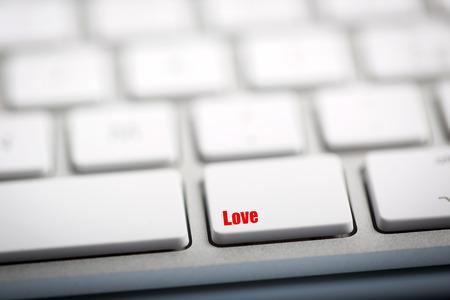 The word LOVE written on metallic keyboard. photo