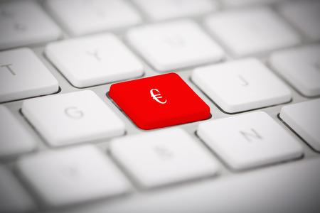 The symbol € written on metallic keyboard photo