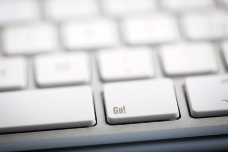 The word GO written on metallic keyboard photo
