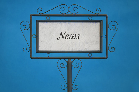 light blue background: The Word News on a Signboard. Light Blue Background. Stock Photo