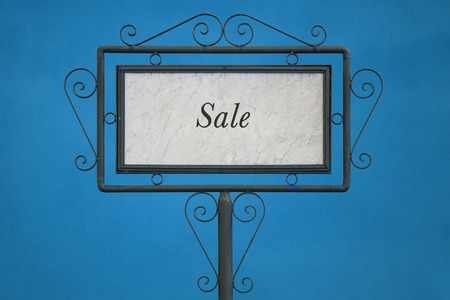 light blue background: The Word Sale on a Signboard. Light Blue Background. Stock Photo