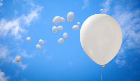 White Balloons on Sky Background in a Wedding Day Stock Photo