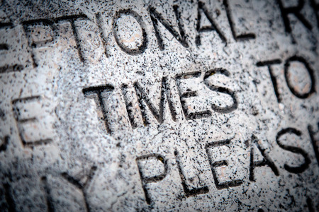 time's: The Word Times Written in Granite Stock Photo
