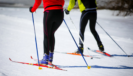 Couple Cross Country Skiing in Engadin, Switzerland Stock Photo
