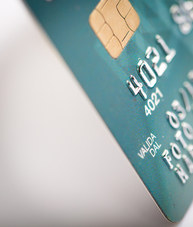 commercial activity: Close up of a green credit card