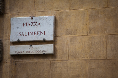 streetsign: The streetsign of Piazza Salimbeni in Siena, Tuscany Stock Photo