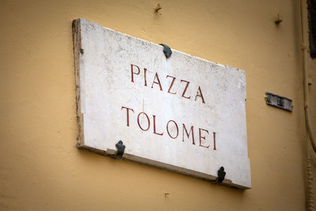 streetsign: The streetsign of Piazza Tolomei in Siena, Tuscany