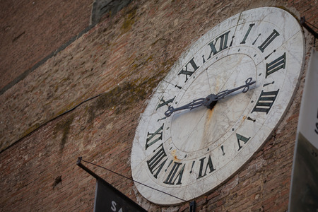 siena italy: Old Clock on a Historic Building in Siena, Italy Stock Photo