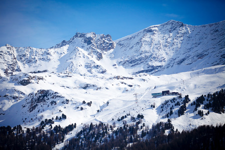 swiss culture: Snow Mountain in Engadin in a Winter Day