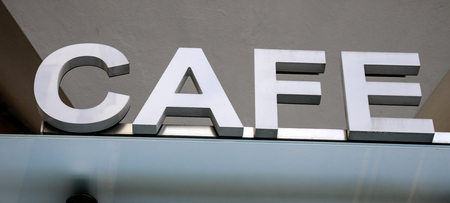 old sign: Cafe sign on an old redundant building Stock Photo