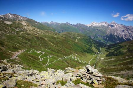 Alpine road on Splugen pass in Switzerland Stock Photo
