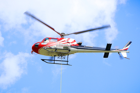 Helicopter in Flight on a Blue Sky in a Summer Day