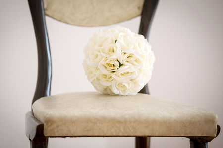 A brides wedding bouquet of white roses Stock Photo