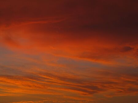 a beautiful orange and yellow evening sky with clouds