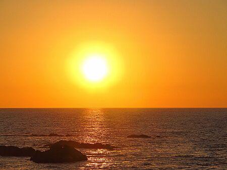 sunset at the sea in Maitencillo beach, central coast of Chile.