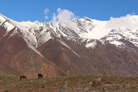 High peaks of snowy mountains on winter in Cajón del Maipo, in the central Andes of Chile.
