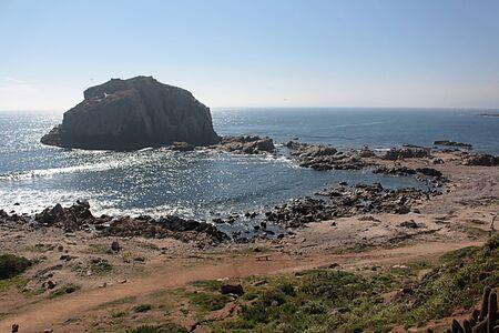 Rocks, cliff and sea in Algarrobo beach, central coast of Chile.