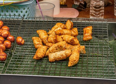 Loock chin plaa tod. An asian style fried fish sausages ready to eat.