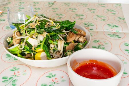 Stir fry vegetables with chicken and tofu.