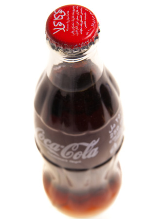 Rome, Itlay October 12, 2011: Bottle of Coca Cola on white background. Coca Cola is a product of Coca Cola Company.