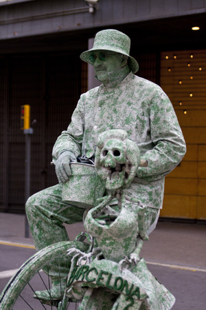 quite time: Barcelona, Spain - May 28, 2011: Street artist in Parc Guel looks like a bronze statue