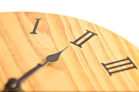 exactitude: Round wooden clock close up