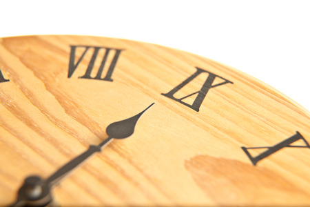 exactitude: Round wooden clock close up
