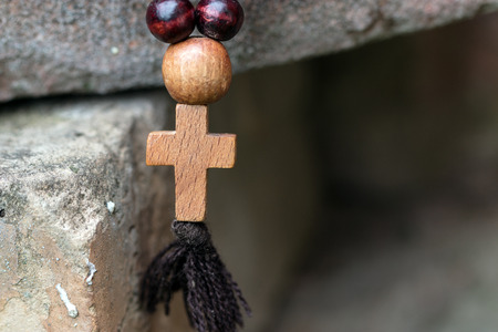 Wooden rosary with a cross Stock Photo