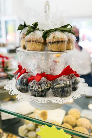 sprinkled: Chocolate muffins sprinkled in powdered sugar Stock Photo