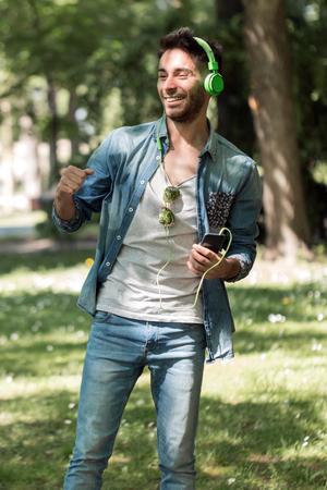 Young man listening to music on a smart phone.Enjoying the rhythm.
