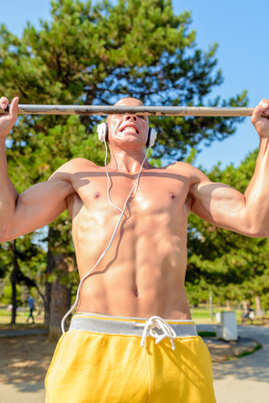 build in: Fit man exercising at the park, leading a healthy life Stock Photo
