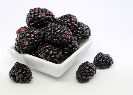Delicious blackberries isolated on white background