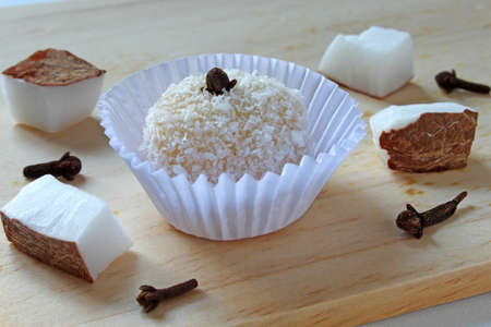 "Candy made from coconut ""Beijinho"", with ingredients: coconut, cloves and sugar"