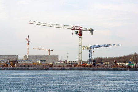 cranes on Mo. S.E. site, between Lido and Pellestrina (Venice Lagoon), building a defence system for hig waters and flood in Venice Editorial