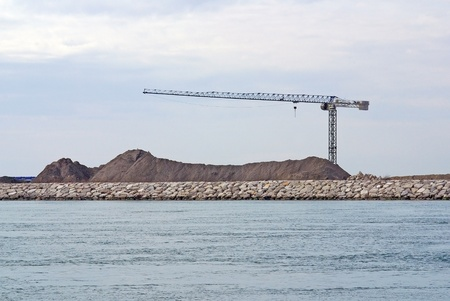 crane on Mo. S.E. site, between Lido and Pellestrina (Venice Lagoon), building a defence system for hig waters and flood in Venice