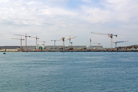 cranes on Mo. S.E. site, between Lido and Pellestrina (Venice Lagoon), building a defence system for hig waters and flood in Venice Stock Photo
