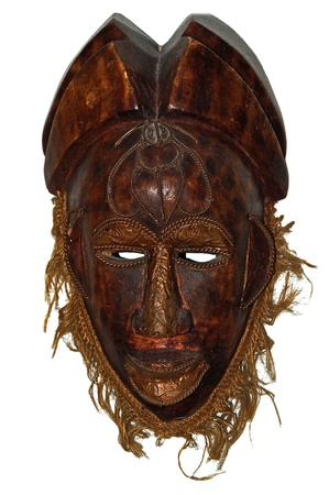 Old african mask with copper details photo