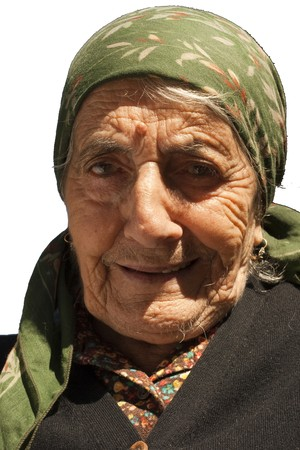 Image shows a portrait of an old Italian happy lady, wearing a headscarf  isolated on white Stock Photo
