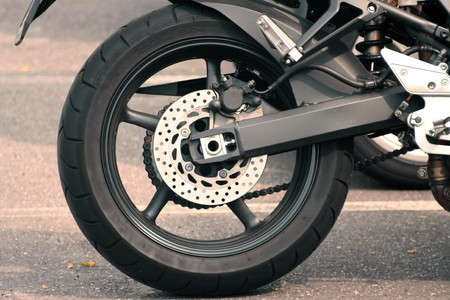 A rear view of a motorcycle, wheel and brake photo