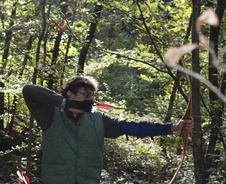 hunter in the wood holding a traditional longbow  photo