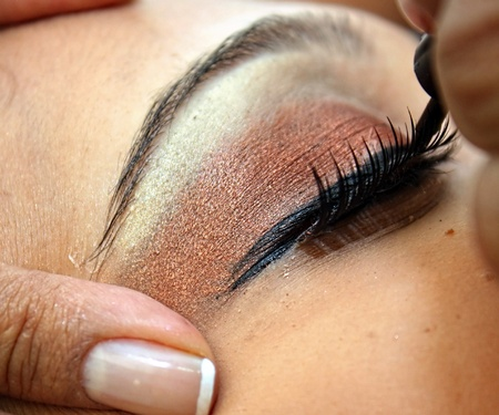Close up of a pretty woman during maquillage process