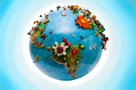 latin  america: South America Globe, with the flowers, made in plasticine Stock Photo