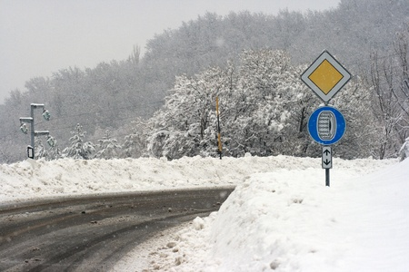 Day Snow Scene .A sign on the side of a rural road photo