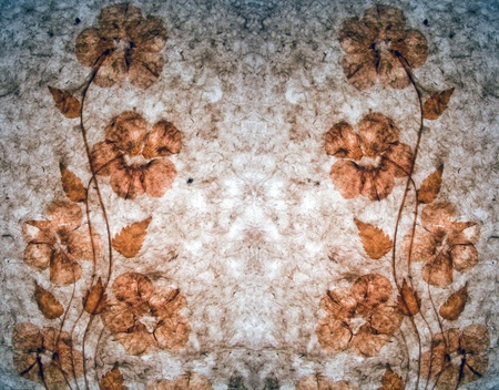 old  hand made paper with decorative dried flowers photo