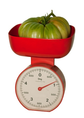 fresh tomato on scales that show the weight in grams  Stock Photo - 8836766