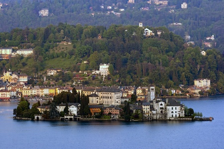ancient pitoresque village over a small island, Orta lake, Italy