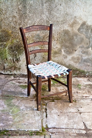 old single chair in a grungy background Stock Photo - 9517086