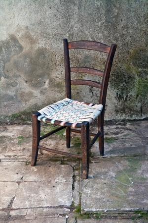 old furniture: old wooden chair over a grunge background